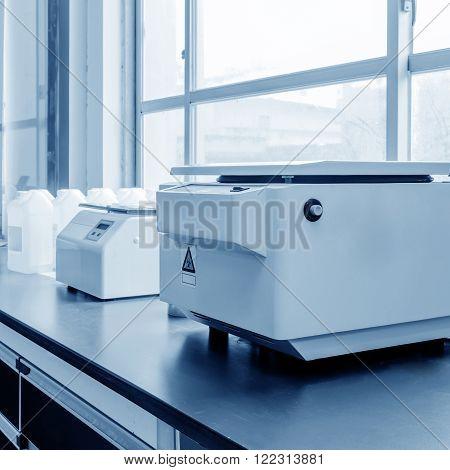 Hospital laboratory equipment, centrifuges, blue tone picture