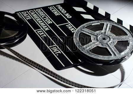 Two Old Reels Of Film And Cinema Clap