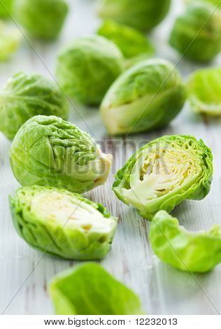Wet brussels sprouts  on the white wooden table