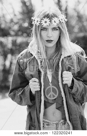 Girl hippie revolutionary in 1970 style  with the symbol of peace and eskimo