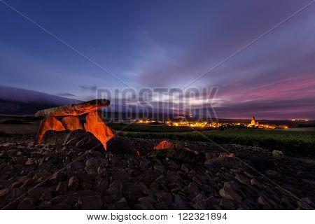 Dolmen closed to a vineyard at sunrise