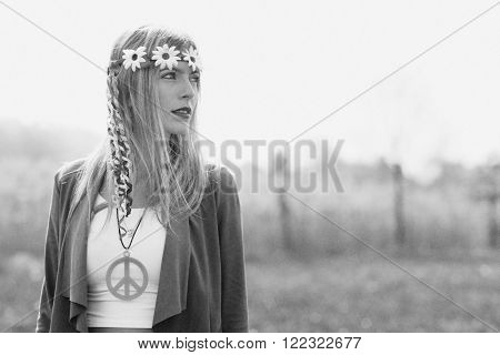 Hippy girl - 1970 style. Old black and white photographic simulation machine