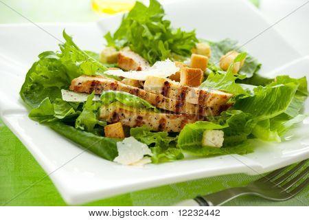 Chicken Caesar salad  on the white plate