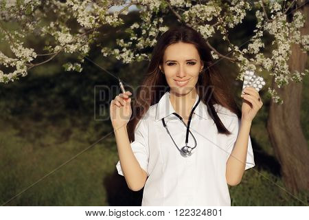 Spring Female Doctor with  Vaccine Syringe and Pills Allergist  holding  immunization vaccine and antihistaminic pills