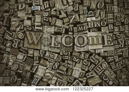 Close Up Of Typeset Letters With The Word Welcome