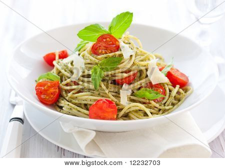 spaghetti with  pesto sauce,cherry tomato and cheese