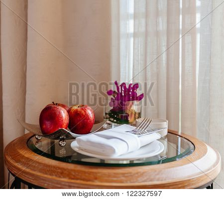 still life with apples and cutlery on the table