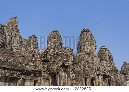 Stone Head On Towers Of Bayon Temple In Angkor Thom, Cambodia