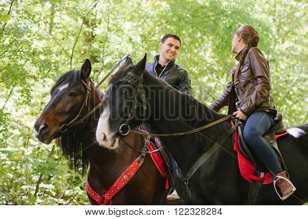 couple in love horseback riding summer forest