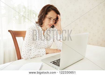Portrait Of A Asian Mature Beautiful Businesswomen Thinking Or Brooding, Work On Portable Laptop Com