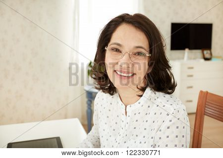 Youngbeautiful Asian Mature Female Using Portable Laptop Computer While Work At Compilation Of Busin