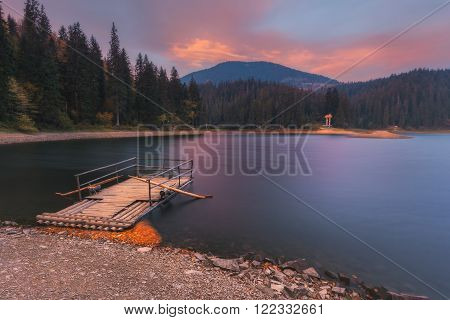 Carpathian Mountains. Beautiful synevir lake morning raft