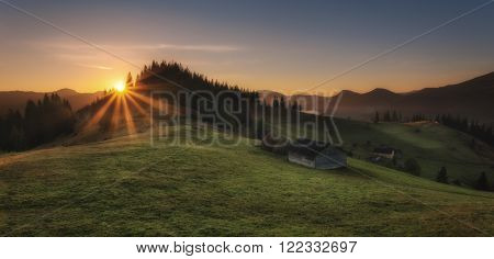 Carpathian Mountains. Morning in the mountains, the house on the hillside.