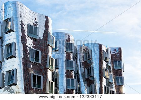 DUSSELDORF GERMANY - DECEMBER 26 2015: View of the Neuer Zollhof in Media Harbor in Dusseldorf Germany. This building complex was designed by Frank O. Gehry and completed in 1998.