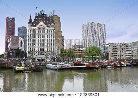 ROTTERDAM, THE NETHERLANDS - 18 AUGUST: Rotterdam is a city modern architecture, Westermeijer Tower and Oude Haven oldest part of the harbour in Rotterdam, Netherlands on August 18,2015.