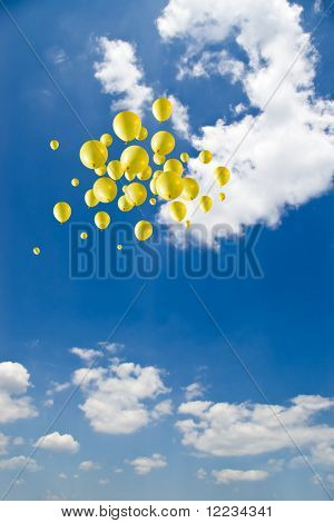 yellow balloons on sky