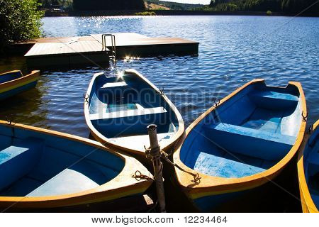 boats lake and pontoon in morning light