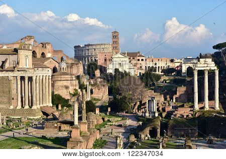 Panorama of Roman Forum and Via Sacra road with ancient monuments and Coliseum in the background