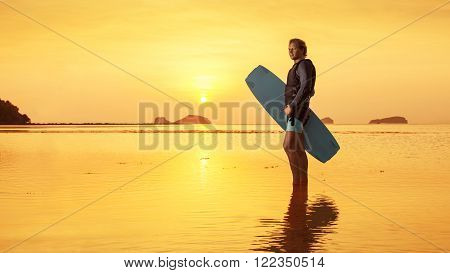 Blond Man With The Wakeboard