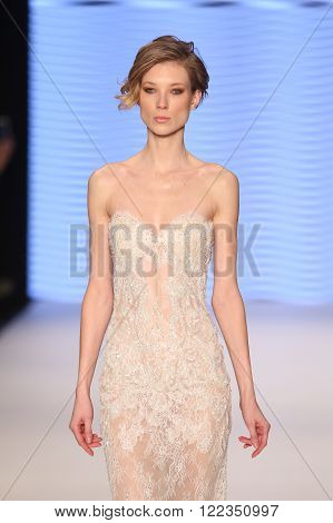 ISTANBUL, TURKEY - MARCH 16, 2016: A model showcases one of the latest creations of Rasit Bagzibagli Couture Catwalk in Mercedes-Benz Fashion Week Istanbul