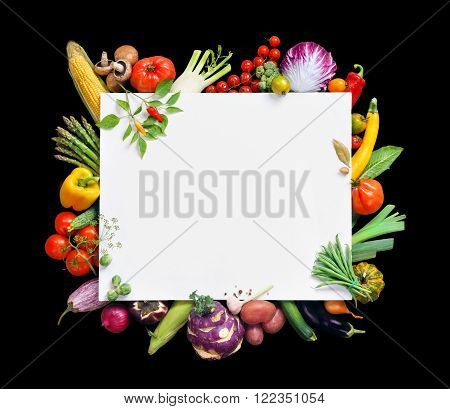 Healthy food background and Copy space. Studio photography of white paper surrounded by fresh vegetables isolated on black background top view. High resolution product