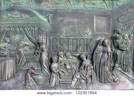 PISA, OCTOBER 31, 2009: A bronze panel in the West front main door of Pisa Cathedral (Catedral de Pisa) Italy