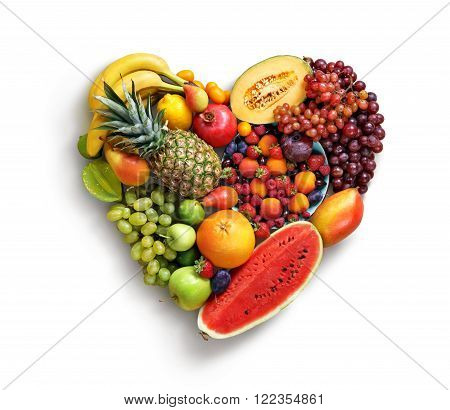 Heart symbol. Fruits diet concept. Food photography of heart made from different fruits isolated white background. High resolution product