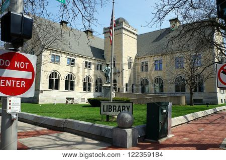 JOLIET, ILLINOIS / UNITED STATES - APRIL 12, 2015: A statue of Louis Joliet, sculpted by Sigvald Asbjornsen, was erected in 1903 in front of the Joliet Public Library.