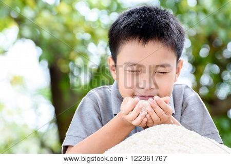 Jasmine Rice In Kid Hand