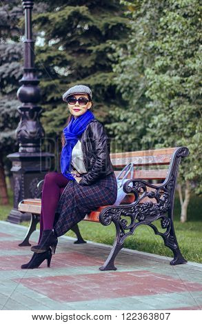 stylish girl in a blue scarf and purple pantyhose