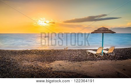 Sunloungers at sunrise on greek Kos island