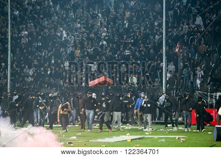 Thessaloniki Greece - March 02 2016: PAOK fans getting arrested after clashing with riot police during the semifinal Greek Cup game between PAOK and Olympiacos played at Toumba stadium