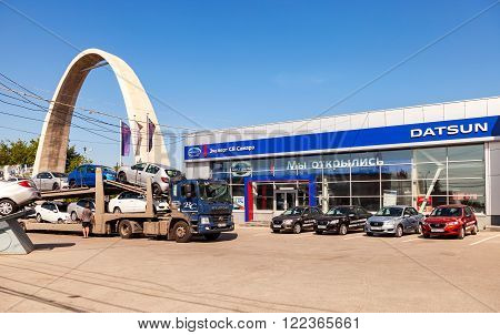 SAMARA RUSSIA - JULY 23 2015: Truck brought new cars to car showroom Datsun