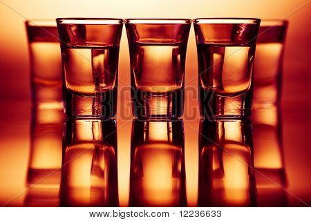 five tequila drinks in red light