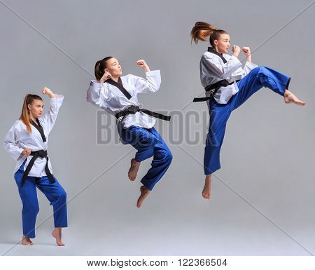 The collage of karate girl in white kimono and black belt training karate over gray background.