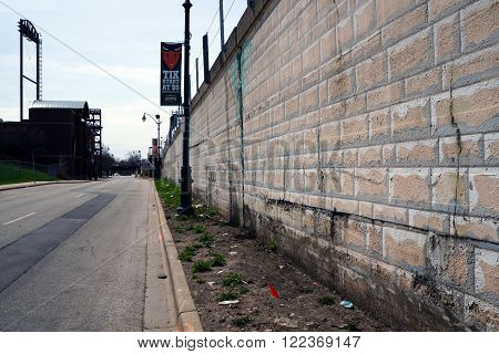 JOLIET, ILLINOIS / UNITED STATES - APRIL 12, 2015: A view down Mayor Art Shultz Drive, which lies between elevated railroad tracks and the Silver Cross Baseball Field in downtown Joliet.