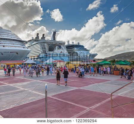 PHILIPSBURG, ST. MAARTEN - JAN. 19, 2011:  Cruise ship passengers in Philipsburg for the day arrive at Dr. A.C. Wathey Cruise Port.  Water taxi's are needed to transport passengers onto the main island for shopping.