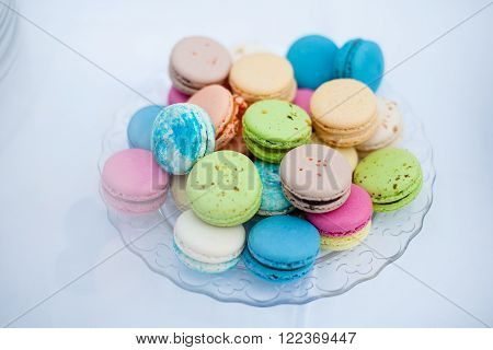 colorful cookies French macaroons on a white plate