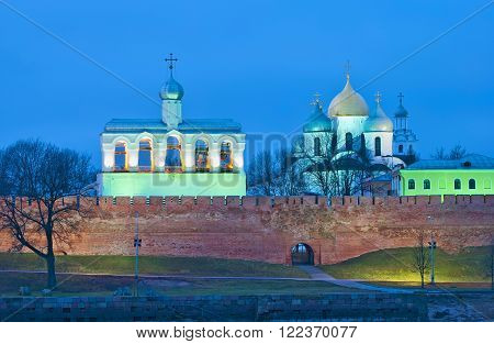 Veliky Novgorod. Russia. The Kremlin Wall, belfry and St. Sophia Cathedral. Night winter view from The Volkhov River.