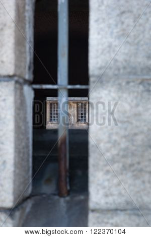A view through an old military fort window.  You can see clear through to the windows on the other side.