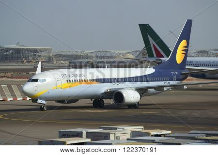 ABU DHABI, UAE - MARCH 27, 2015: Boeing 737 Next Gen (VB-JBK) airlines Jet Airways closeup. Abu Dhabi Airport