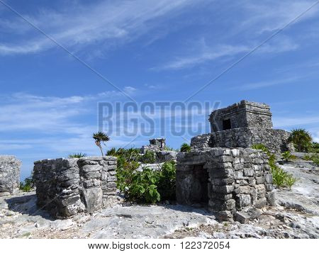 El Castillo the most important temple of the archeological Mayan complex Tulum with other small temples Yucatán Peninsula Mexico.