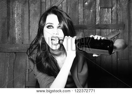 Woman Opening Wine Bottle
