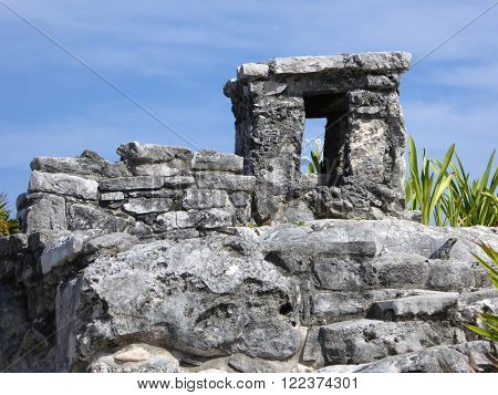 A stone tower in the ruins of Tulum a Mayan archeological site in the Yucatán peninsula of Mexico.