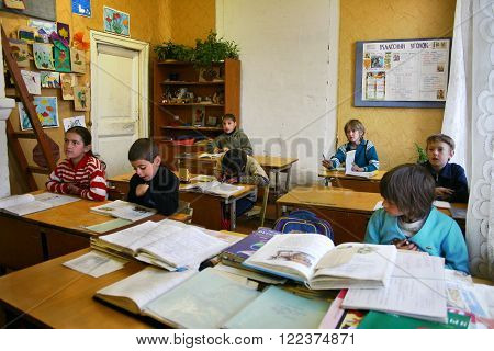 Podol village Tver region Russia - May 5 2006: Students are sitting at their desks in a classroom during a lesson elementary rural school.