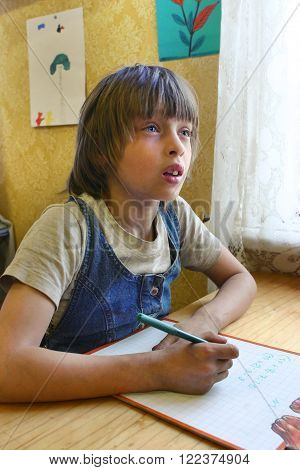 Podol village Tver region Russia - May 5 2006: Junior schoolchildren Nadia Yarunicheva 7 years old on math lesson in the village school.