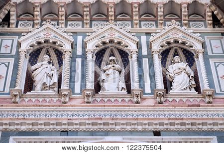 FLORENCE, ITALY - JUNE 05: Statues of the Apostles and the fine architectural detail of the of the, Portal of Cattedrale di Santa Maria del Fiore, Florence, Italy on June 05, 2015