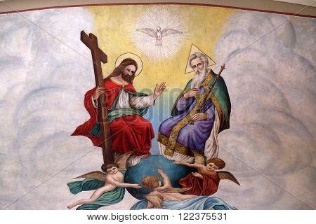 STITAR, CROATIA - AUGUST 27: Holy Trinity, fresco in the church of Saint Matthew in Stitar, Croatia on August 27, 2015