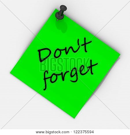 Don't forget. Note paper with pushpin. Green sheet for notes fastened on a white wall with use black pushpin and inscription