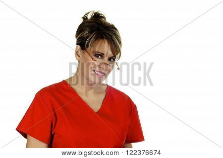 Attractive Female Nurse wearing red scrub top isolated on white background